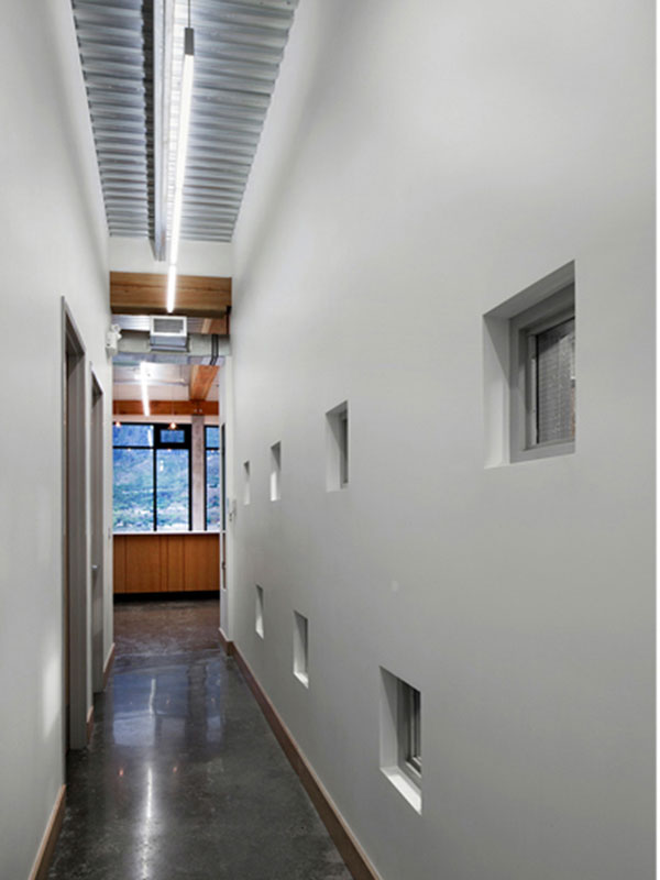 A corridor provides aesthetically controlled glimpses of the winemaking functions.