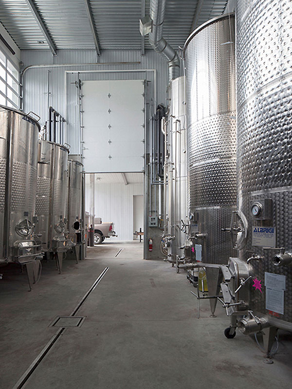 Fermentation tanks housed in a milti leveled space.