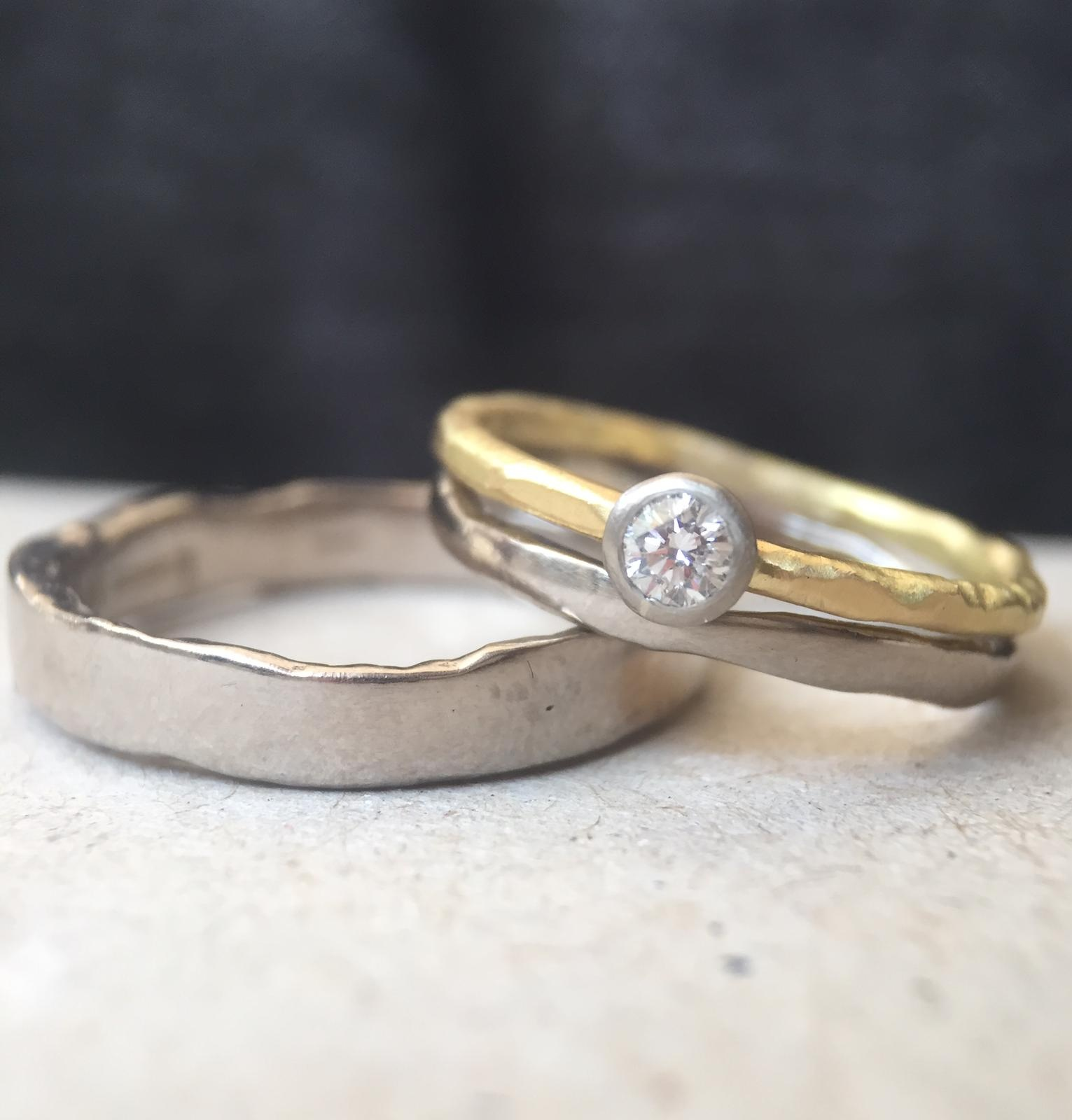 All of our wedding ring range is available in fair trade gold.  Image shows 18ct white gold Taw and Sid along with a diamond engagement ring in 18ct fair trade yellow and white gold by  Erin Cox .