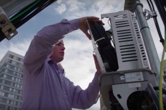 Source:    arlnow.com   , Verizon worker installing 5G equipment onto Arlington building