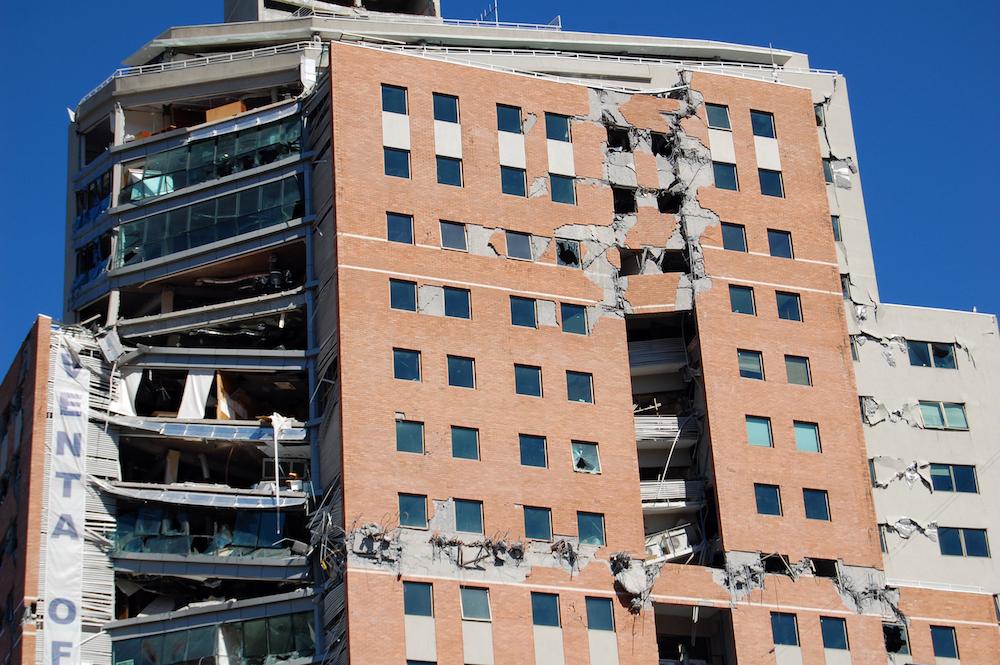 Source:    newscenter.lbl.gov   , Building with earthquake damage.