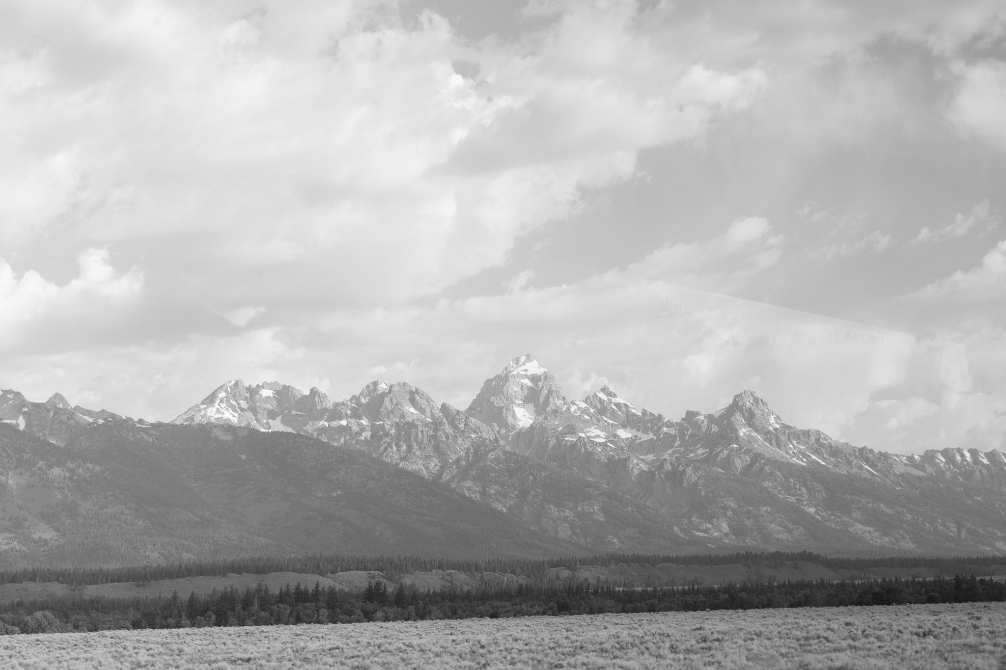 An unprocessed black and white photograph of the Grand Teton Mountains; this was the frame taken just moments before the one turned into 6000 Feet.