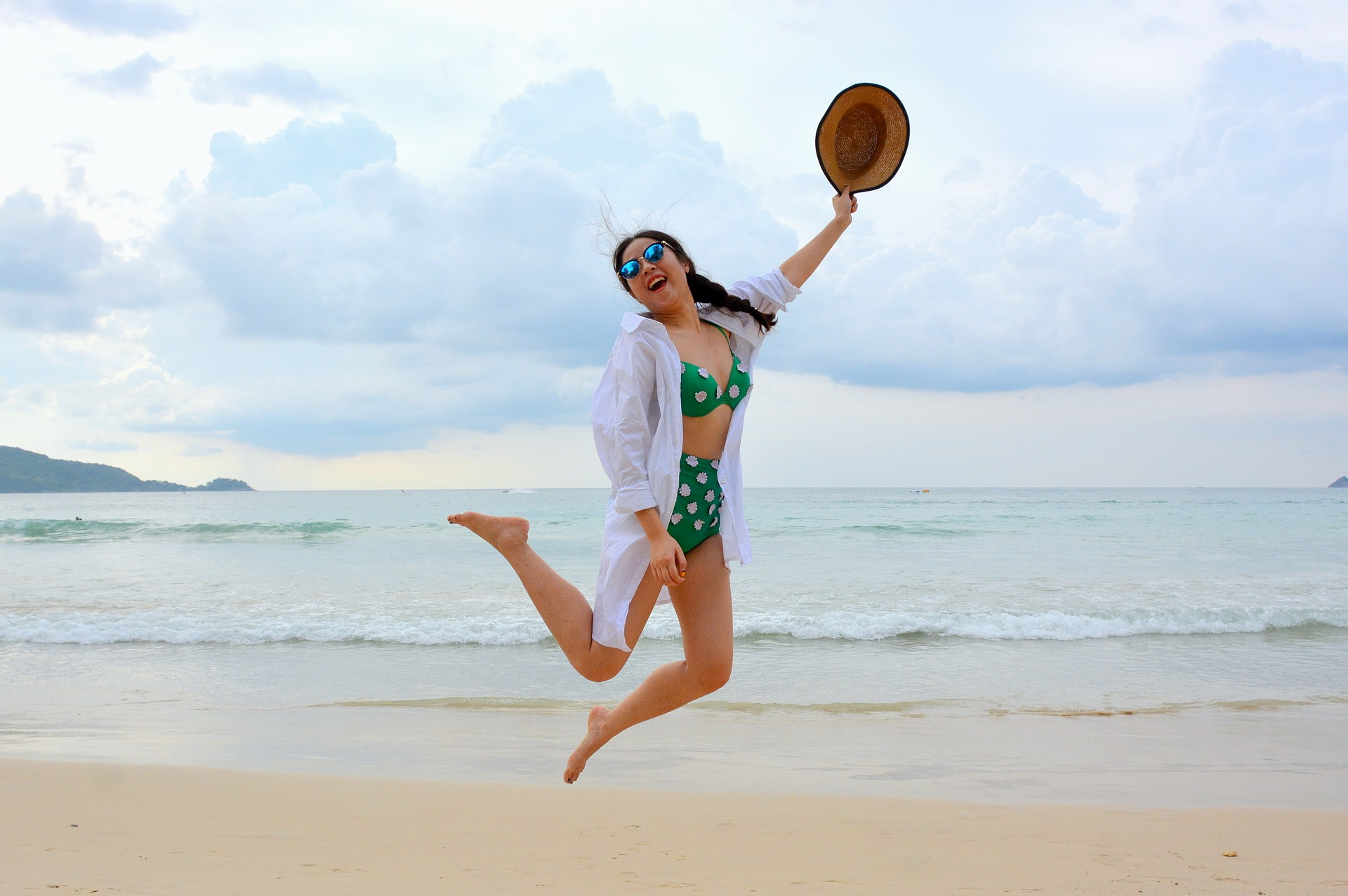 Woman Jumping On Beach.jpeg