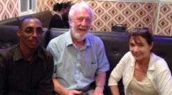 Ibrahim, RoseAnn and her long time friend, Father Brian Starken, discussing TVL over lunch.