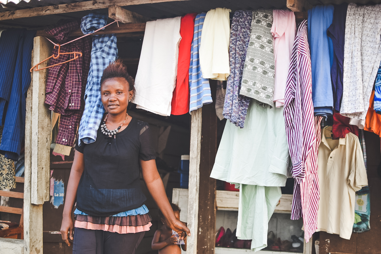 Mariam participated in TVL's entrepreneurial mentorship program. Today she has her own used clothing store. She also purchases palm oil from local farmers in Golu to resell in the Bo market. She's passionate about business and feels proud to be able to help support her family.