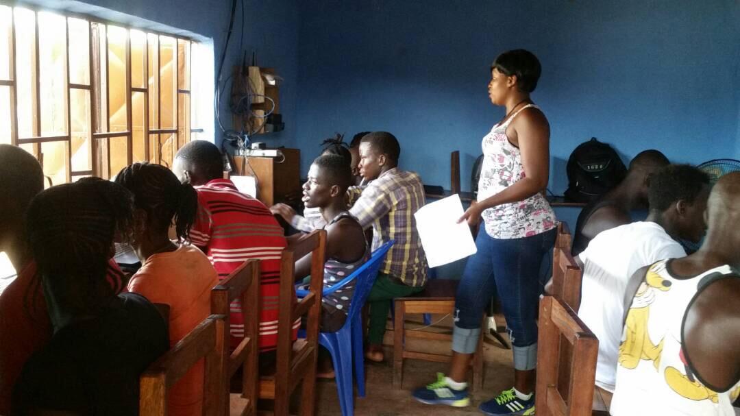 TVL's female instructor, Anita teaching the high school senior class in Golu.