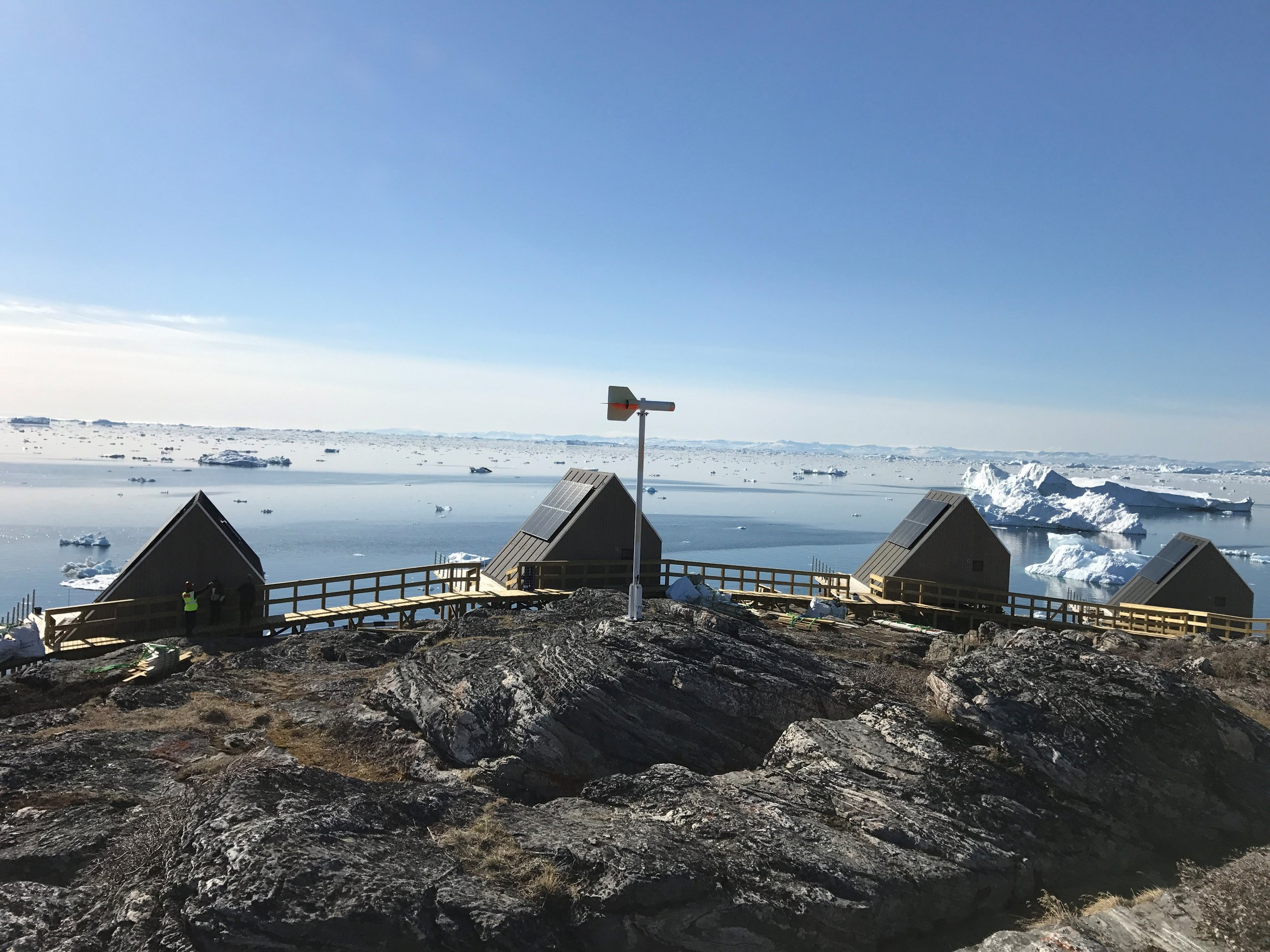 Some of Ilimanaq Lodge's charming coastal cabins