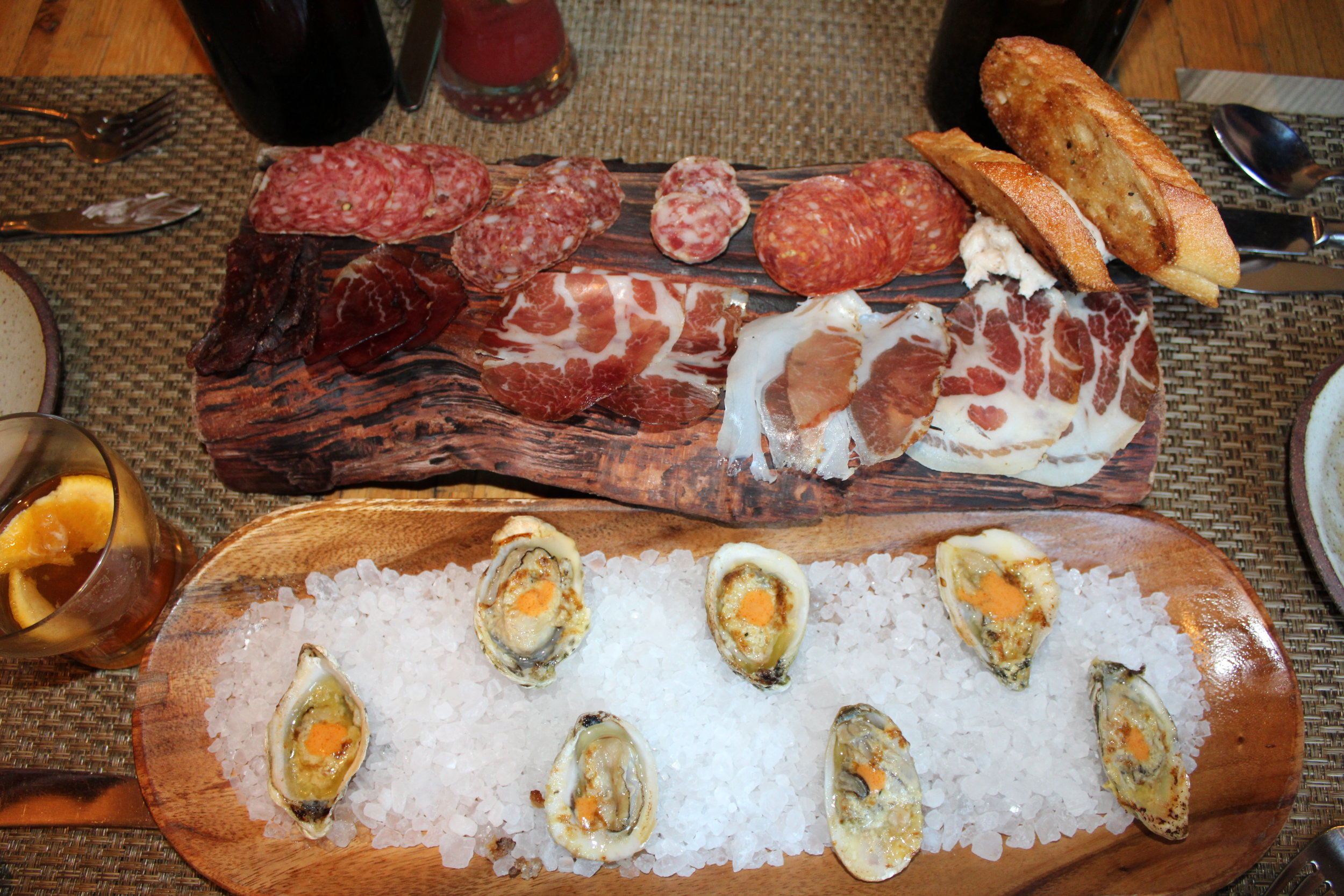 Top: Meat Plate (lardo in the top right corner and beef jerky in the bottom left. Bottom: Oysters.
