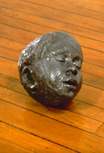lead head, 1999 cast lead, 23 x 19 x 24 cm.