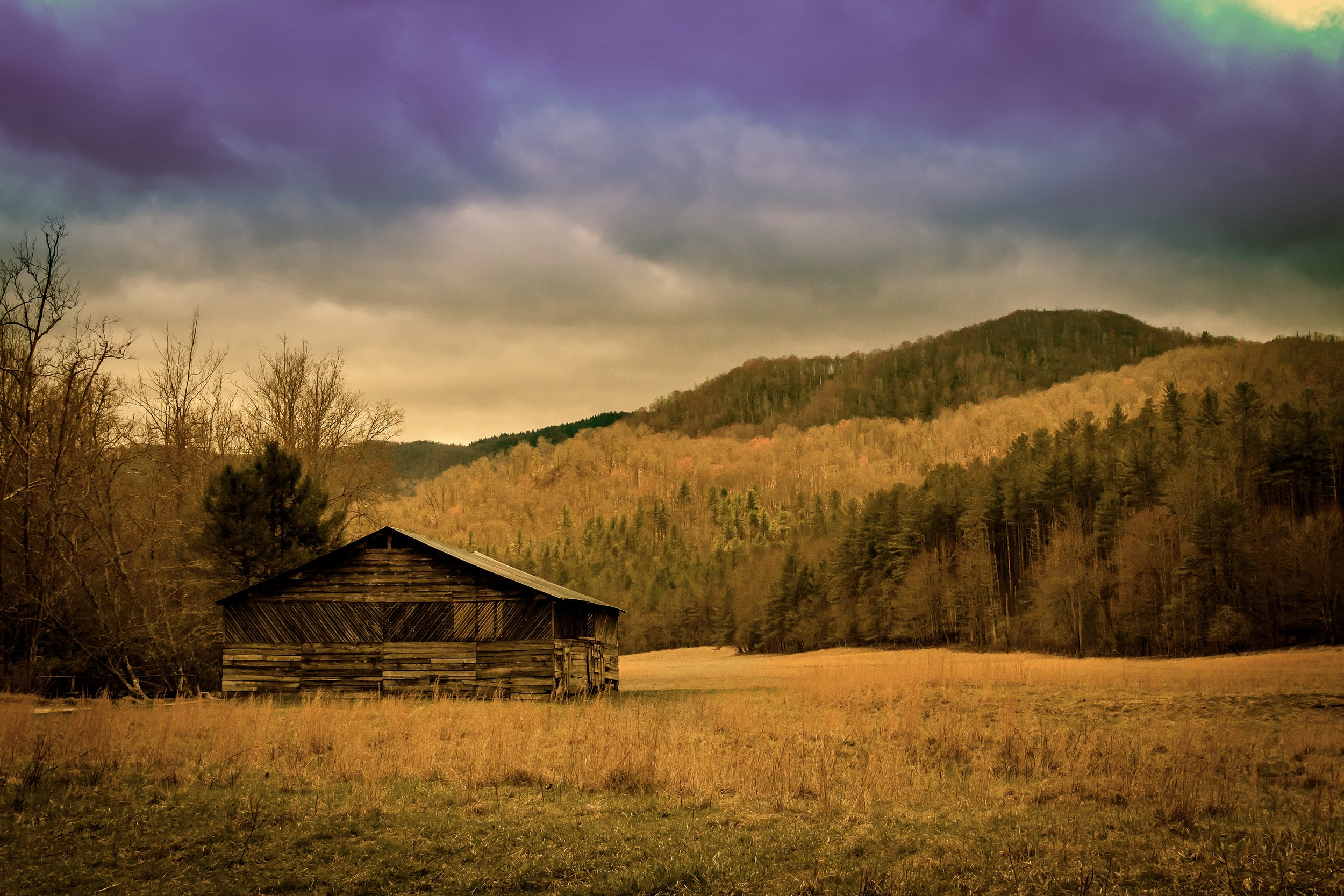 An abandoned barn off a rural road in the Great Smoky Mountains . It was taken with a Canon 7D and an EF-S 18-200 lens. F/8, 1/2,200, ISO 1600, 35mm. Edited in Lightroom.