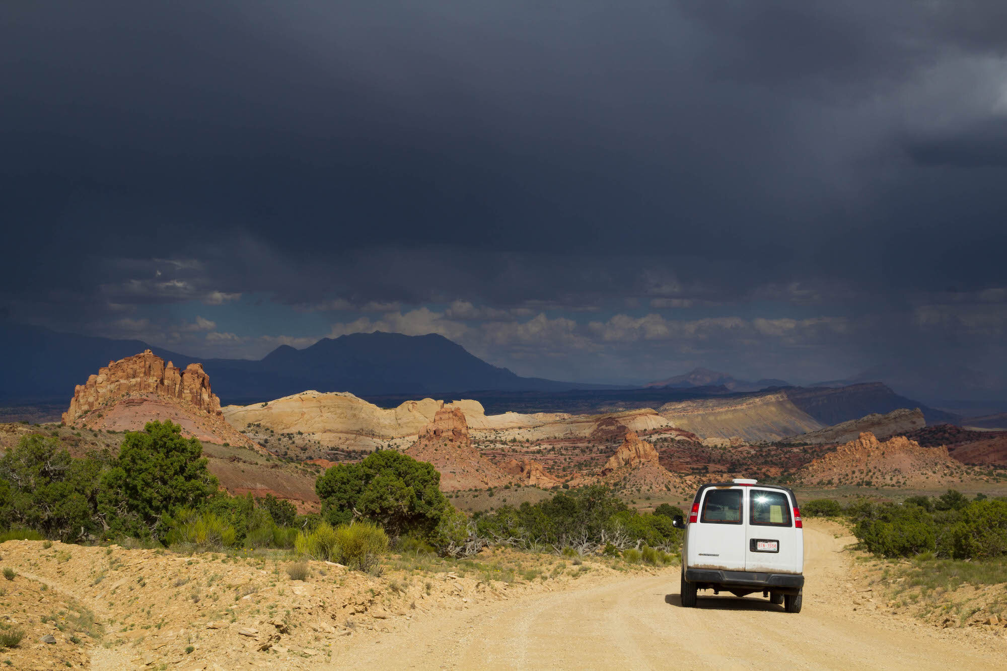 Stormy skies while approaching the Waterpocket Fold on the Burr Trail Road