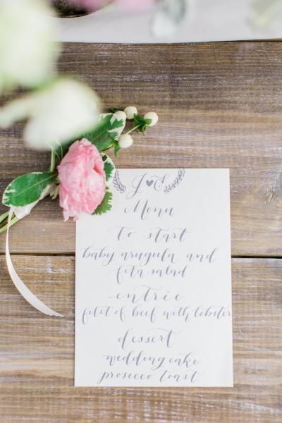Handwritten menus in a custom gray mixed ink