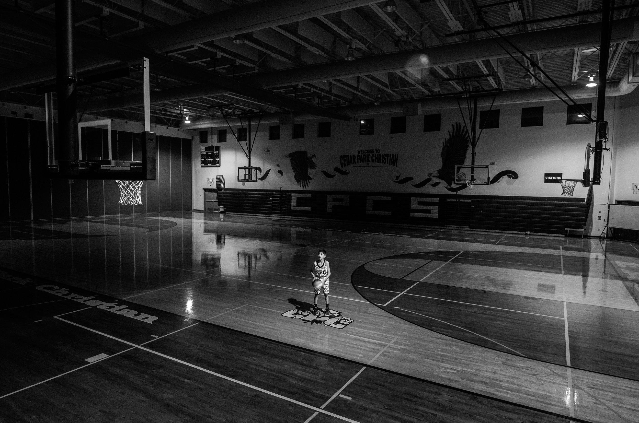 negative-space-young-boy-basketball-gym-black-white-jesse-orrico.jpg