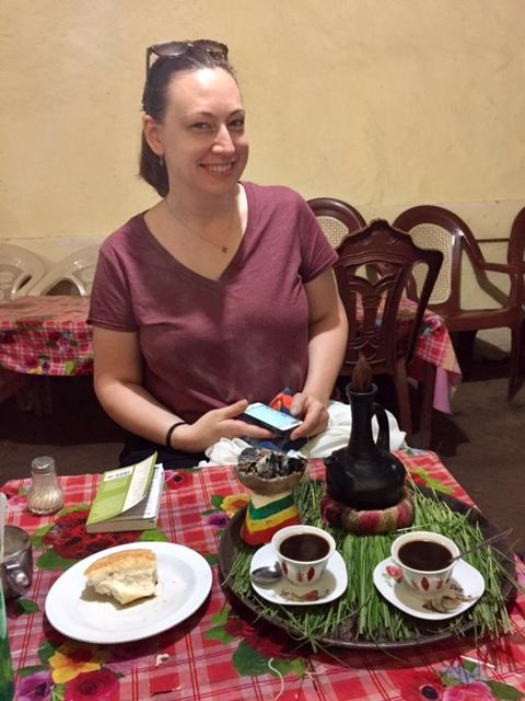 Elizabeth enjoying coffee ceremony at Three Sisters cafe
