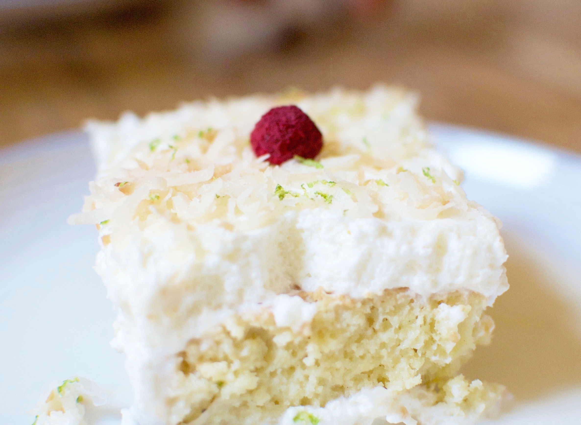 ras malai cake ~ coconut cream soaked cardamom tres leches cake with toasted coconut & lime zest whipped cream