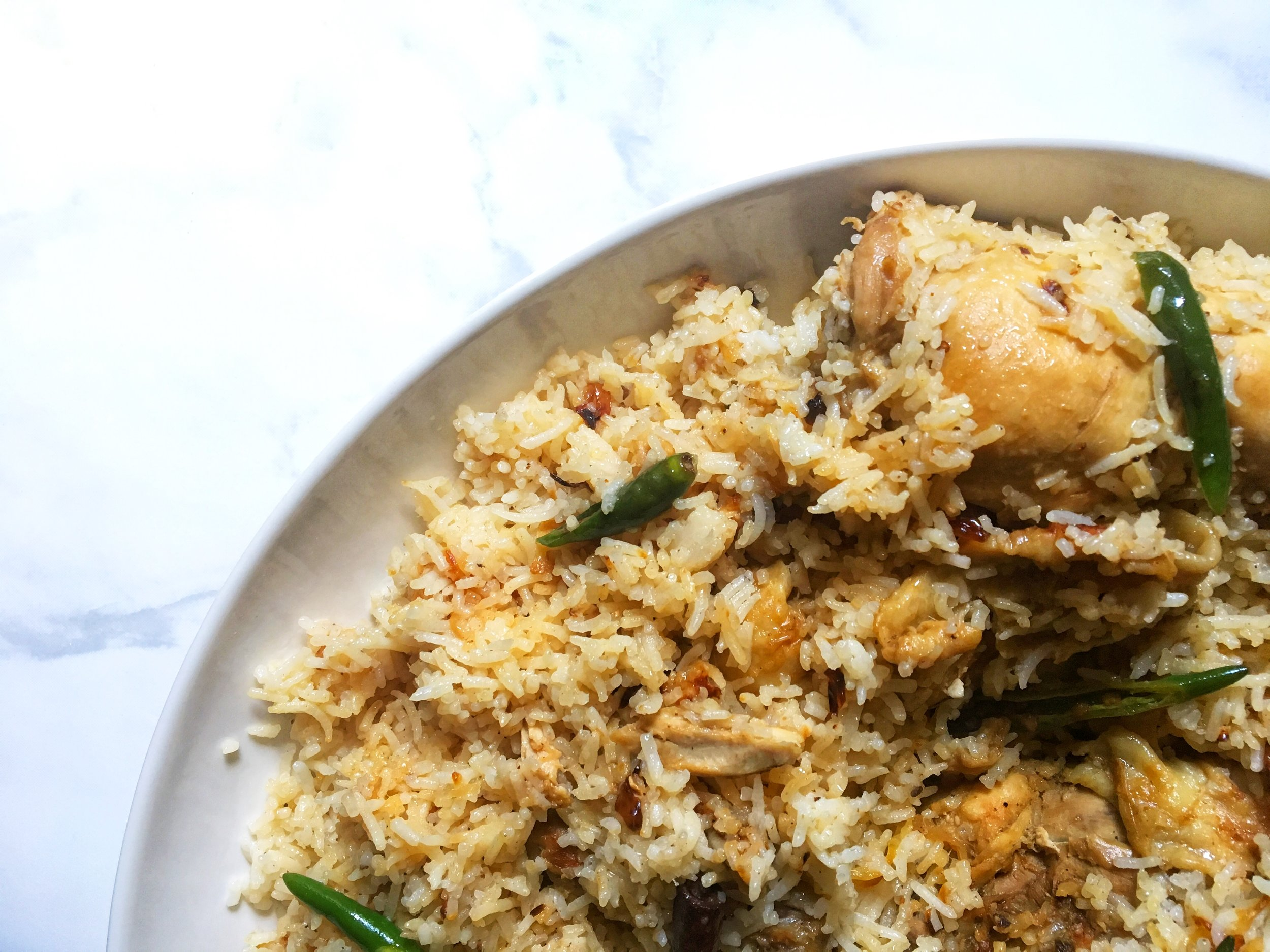 morog pulao: bengali chicken & basmati rice with ghee, caramelized onions, whole garam masala, and green chilies