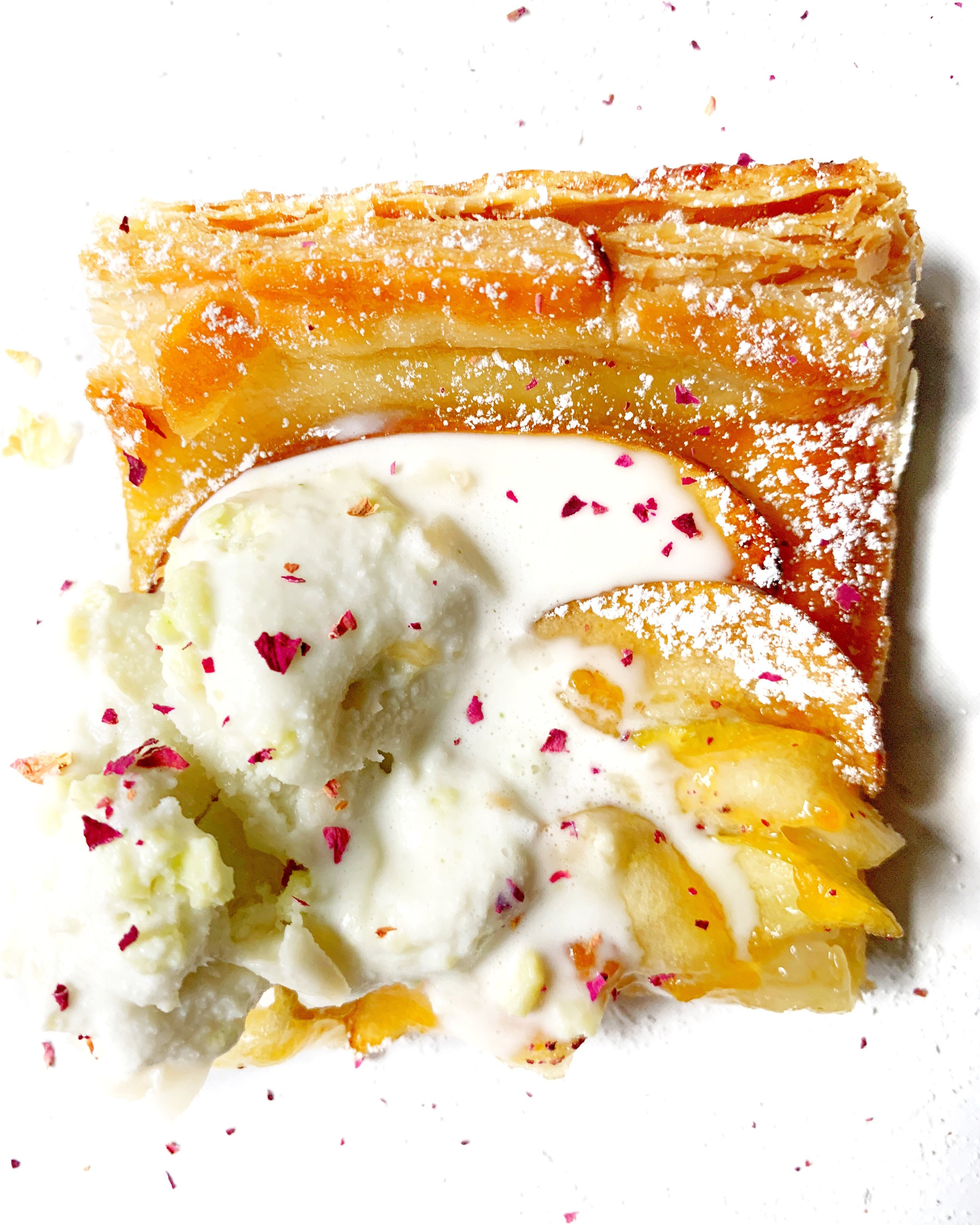 the simplest apple tart with apricot jam, coconut & kaffir lime leaf ice cream, & crushed dried edible rose petals ~