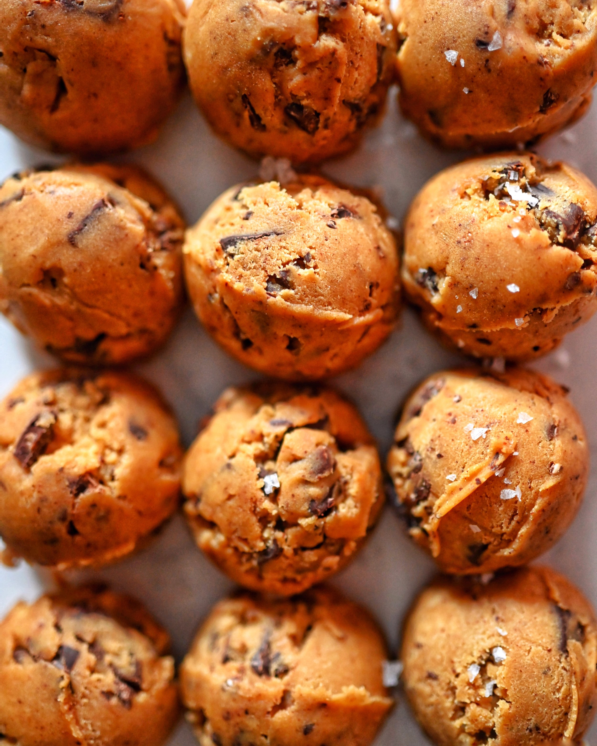 brown butter cookies with dark chocolate, toffee bits, caramelized almonds, & flaky sea salt