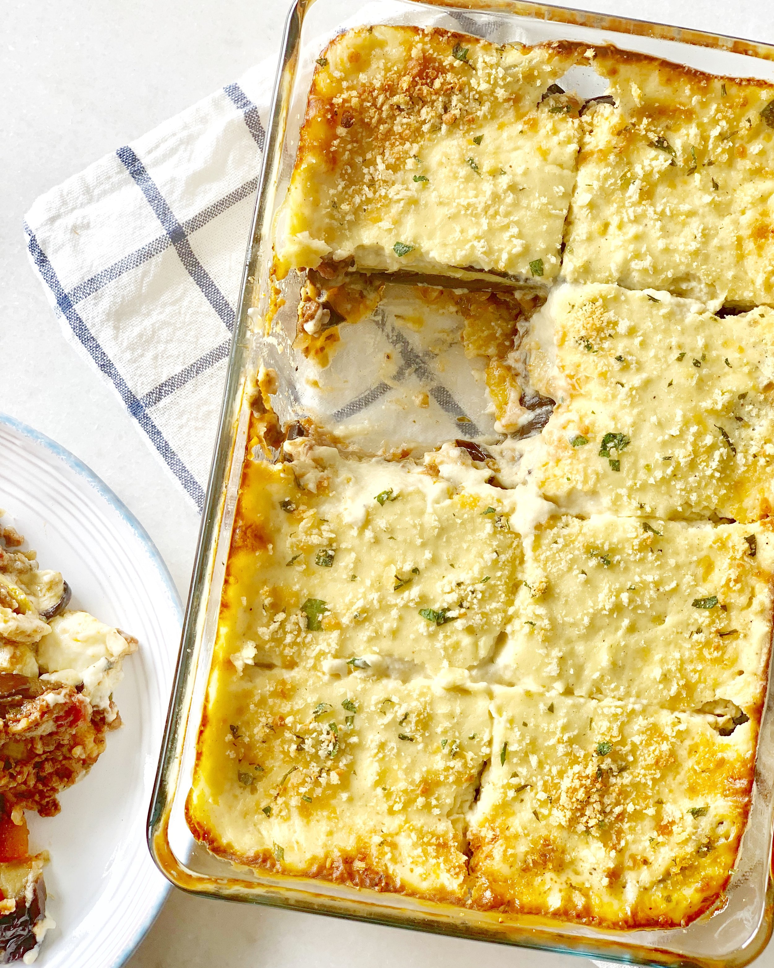 Moussaka: a hearty Greek casserole with layers of eggplant, potato, and minced meat all topped with a thickened and cheesy béchamel.