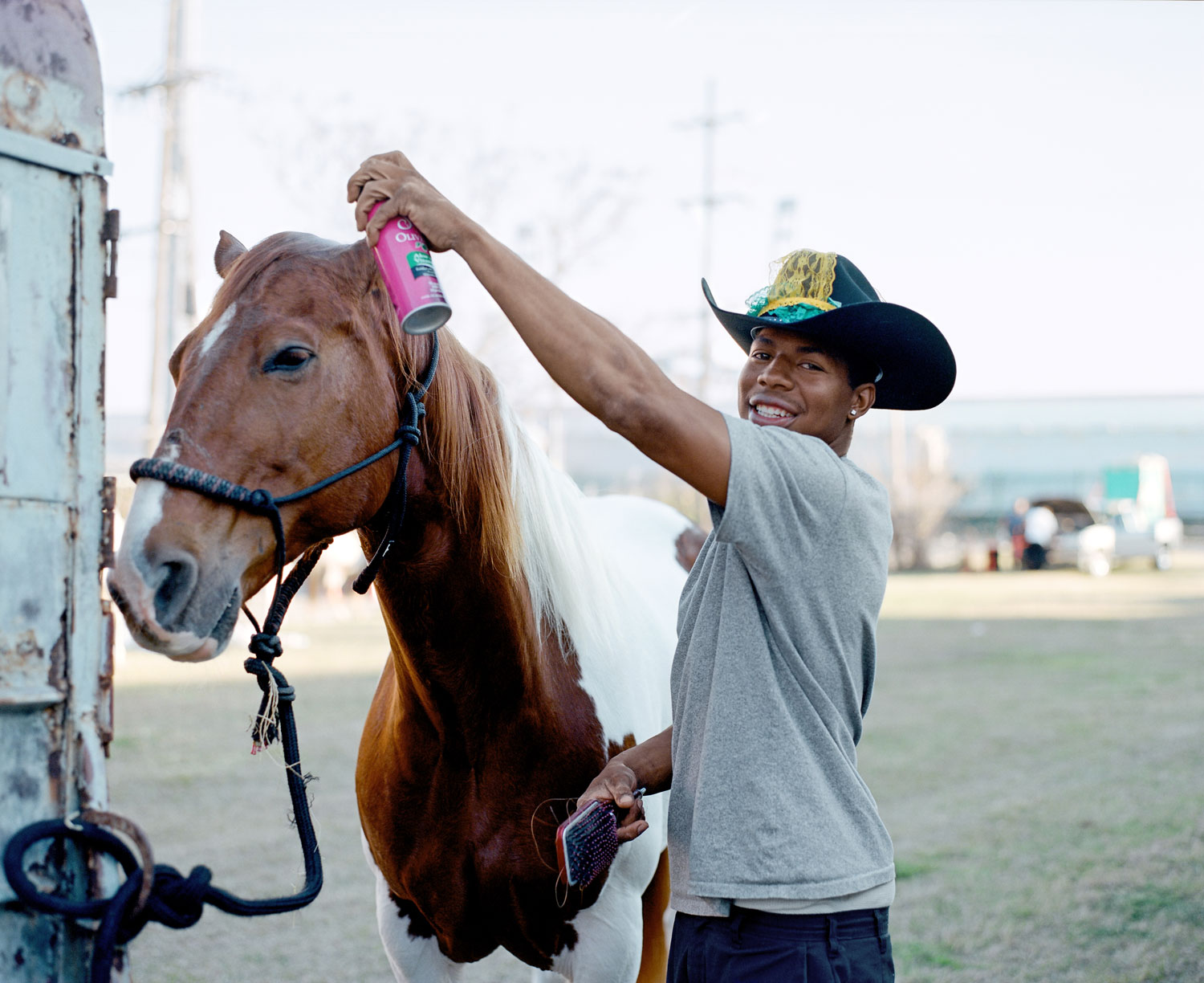 Devence grooms his horse, Cane, before a Mardi Gras parade