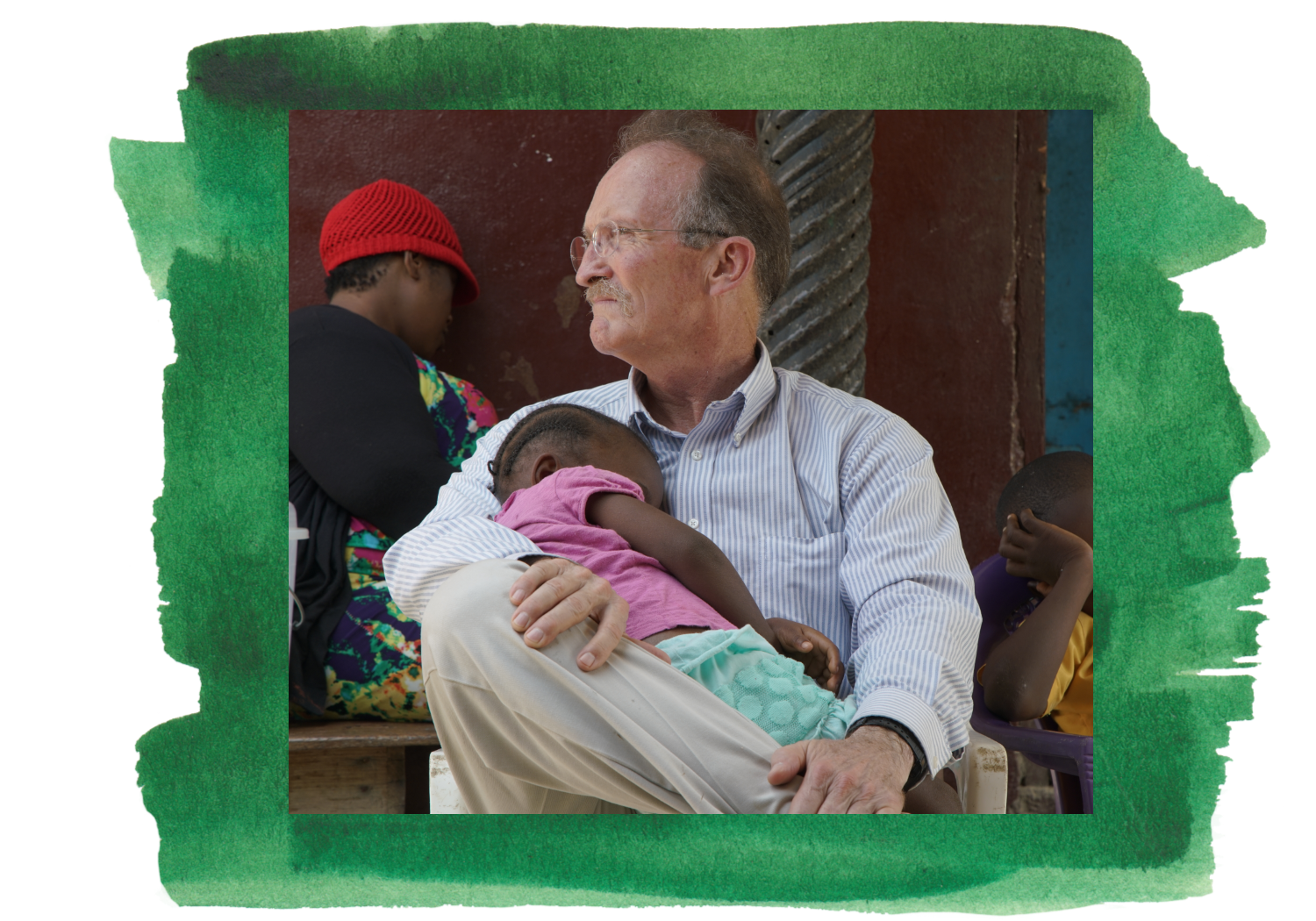 Peace Corps volunteer Dr. Kevin Rodgers holds a sleepy child during filming in Liberia.