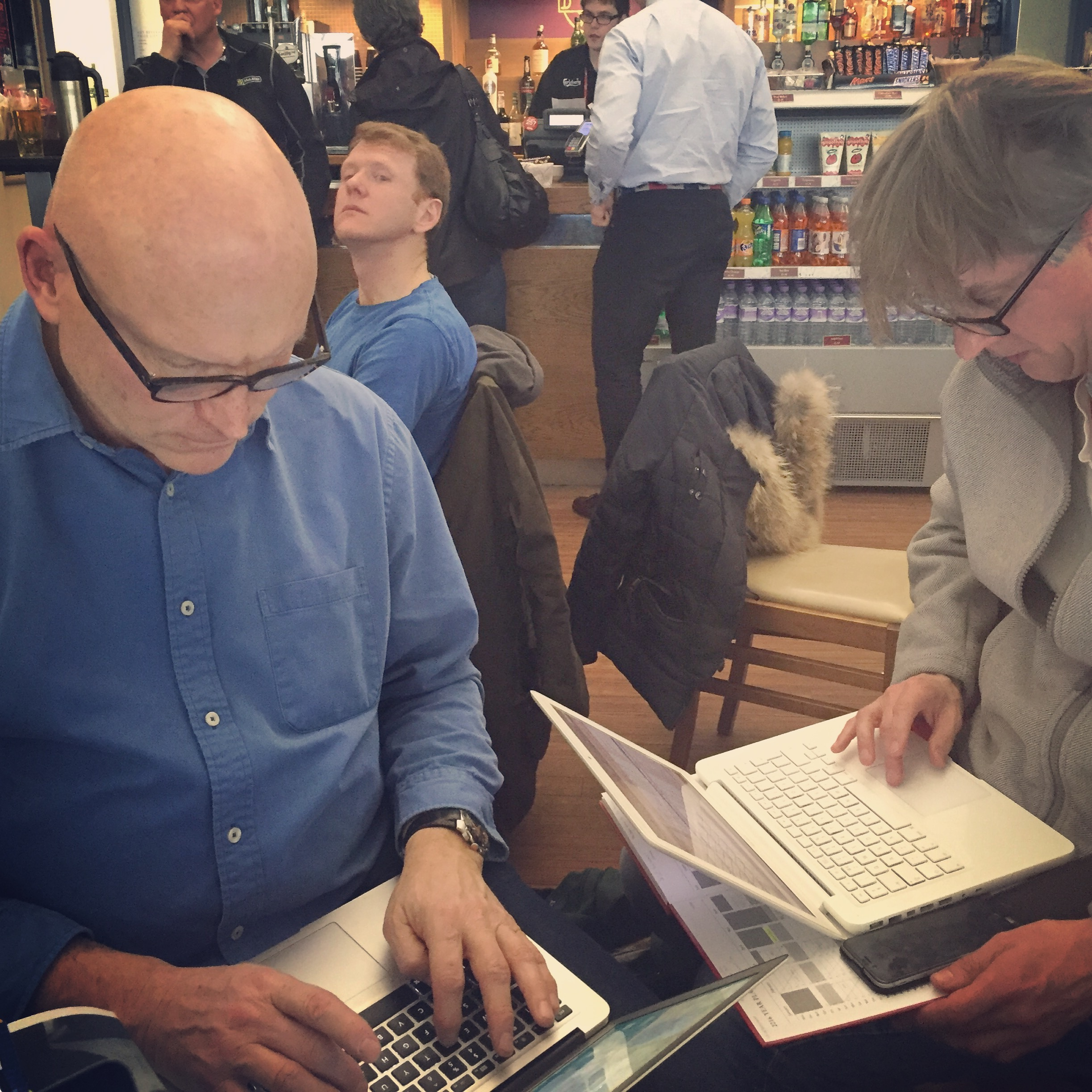 Producer Mark Stothert and Co-Producer Tim Dennison run the numbers at Inverness airport, after a scout