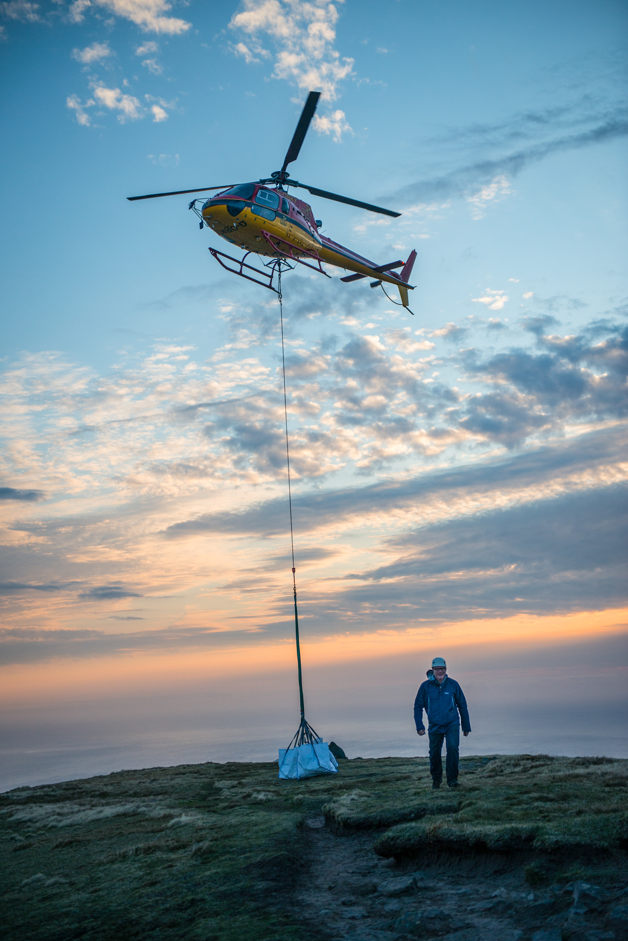 A helicopter lifting grip equipment off the top of Suilven mountain in Sutherland. The entire crew and cast hiked to the summit but a helicopter was used to remove heavy bags back down to the unit base