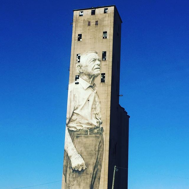 Silo art and blue skies.