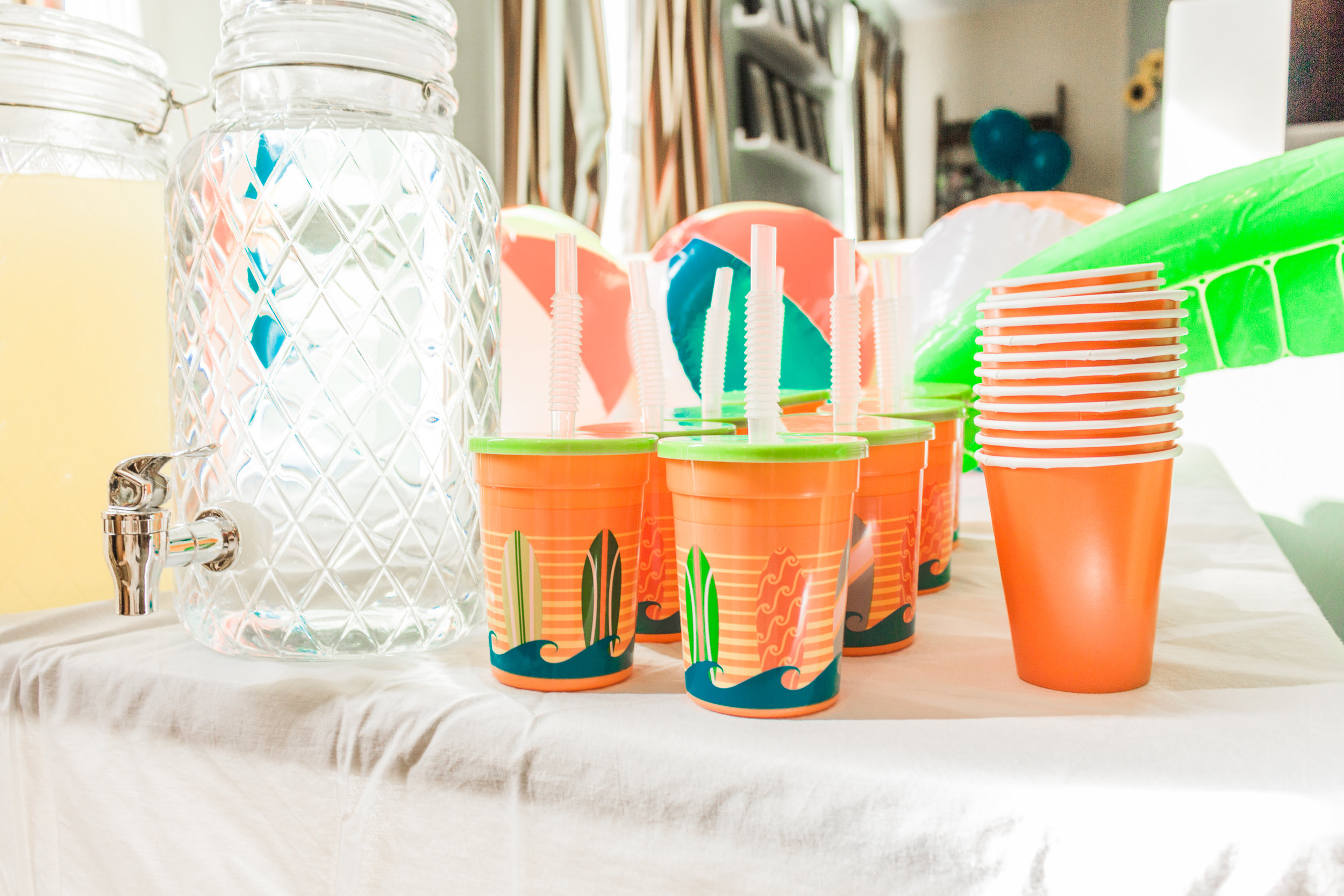 We had a pitcher of water and lemonade ready for the guests, along with  Surfs Up Cups with Straws  for the kids, and  Orange Paper Cups  for the adults!