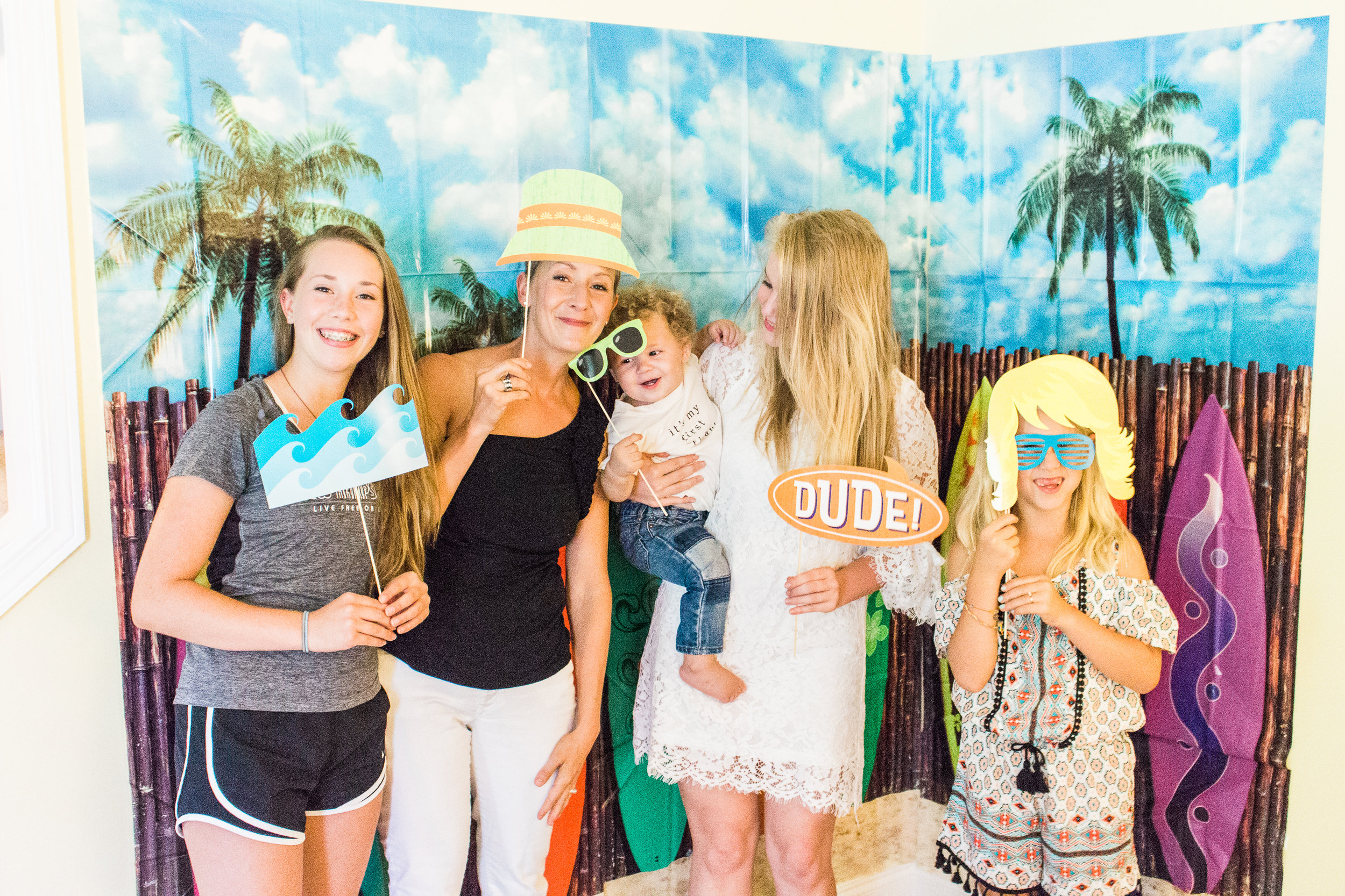It was so fun to have our  Surf's Up Surfboard Backdrop  with  Surf's Up Photo Stick Props . It was a perfect place for the kids to take photos while the adults chatted! The photo sticks were seriously adorable -- look at Aimery's sunglasses!!!