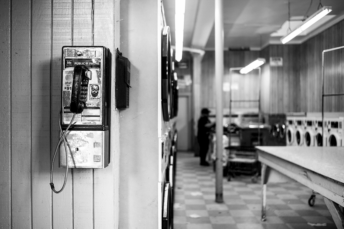 Telephone in Laundromat, San Francisco Mission District, California, USA by Leica Photographer Manuel Guerzoni