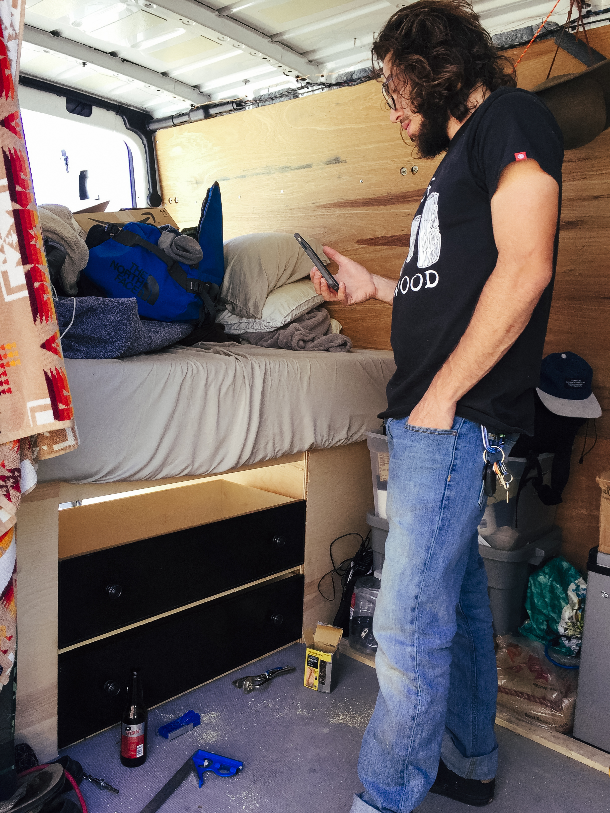 Here's Tom slacking. You will notice the space left above the drawers for the table that will slide out and be placed elsewhere in the van.