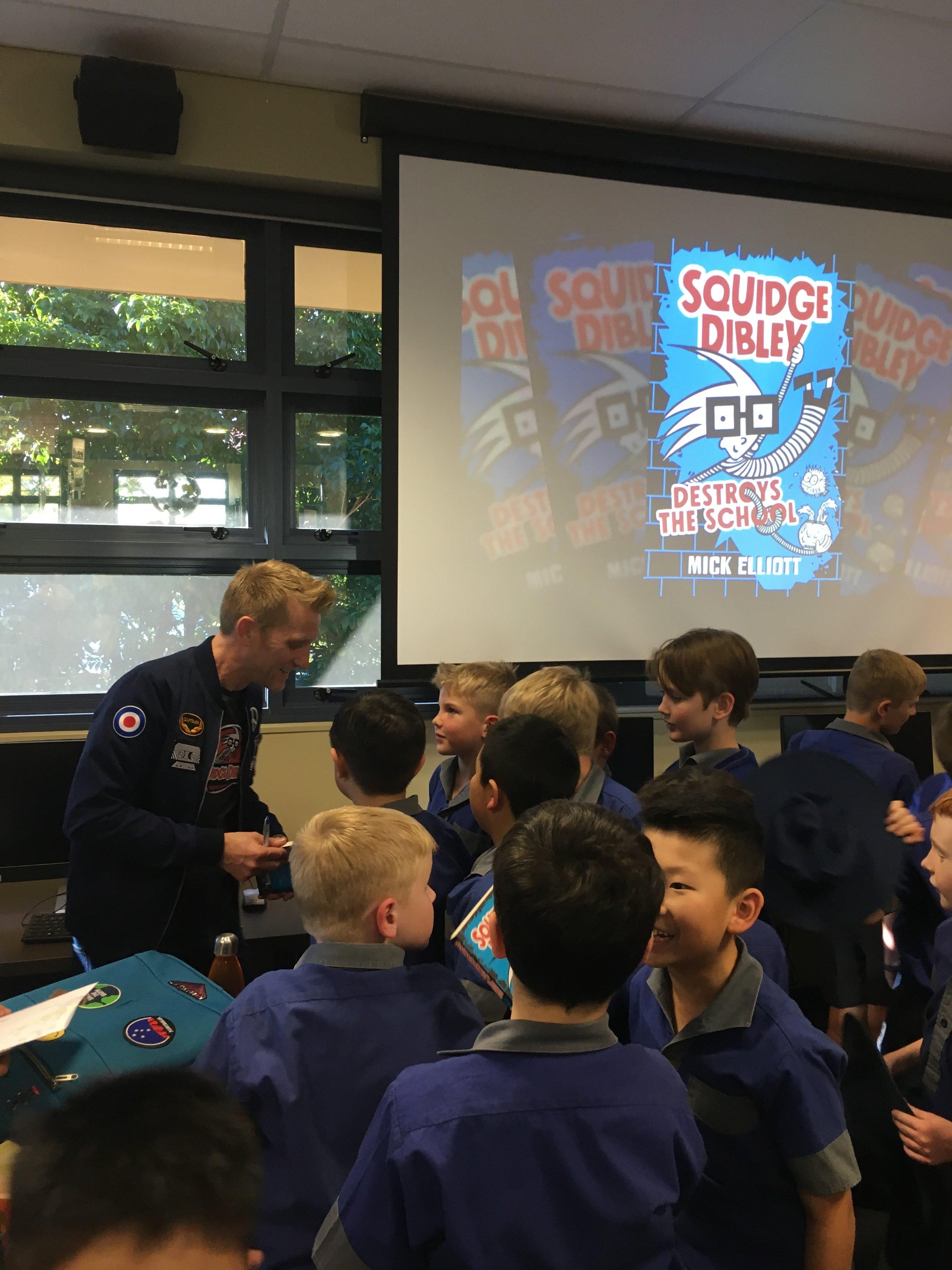 Meeting SQUIDGE DIBLEY fans during a 2019 school visit.