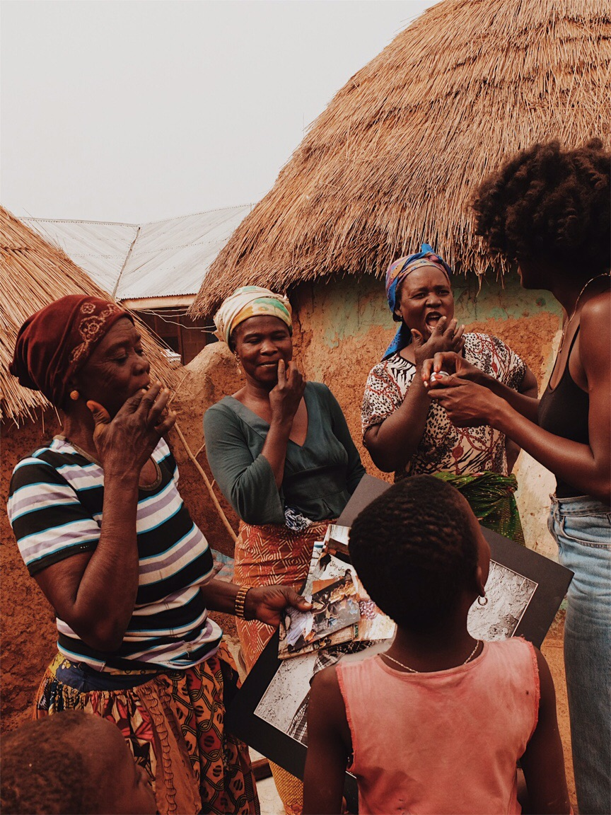 Abena Boamah shares Hanahana Beauty's shea balm with Memunatu, Samantha, and Rukaya of the Katariga Women's Group in Tamale, Ghana