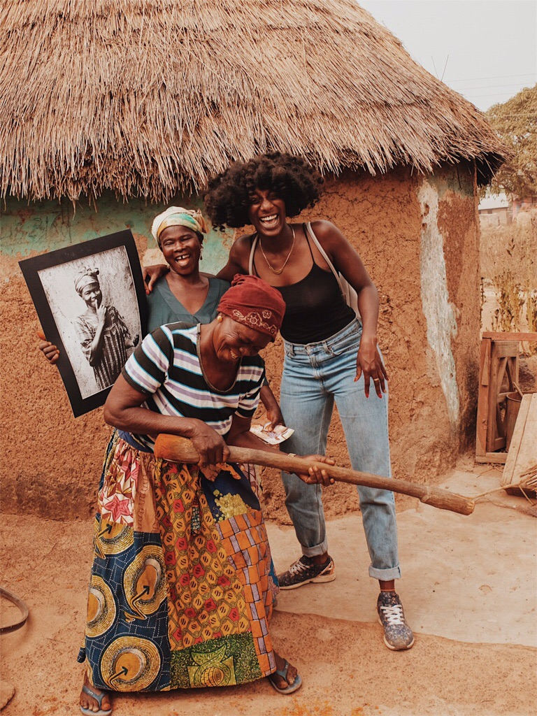 Samantha proudly holds her portrait with Memunatu and Abena    Photos by  Jessica Sarokdie