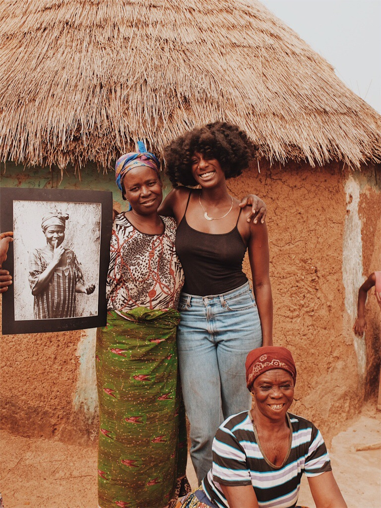 Rukaya displays Samantha's portrait with Abena and Memunatu