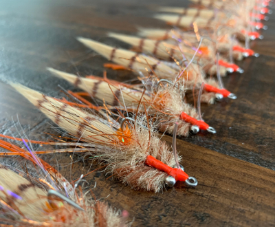 The best redfish flies are the Kwan Fly or the Redfish Toad Fly.