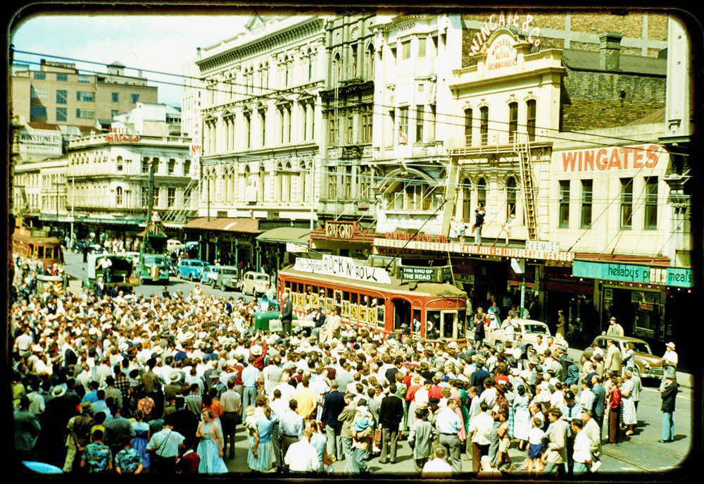 LAST TRAM: Aucklanders flocked to Lower Queen Street opposite the Chief Post Office to see the last tram run in 1956 before the services ceased and the tram tracks torn up because of a decision that buses would dominate public transport (Photo: Sir George Grey Special Collections, Auckland Libraries, 1207-881)