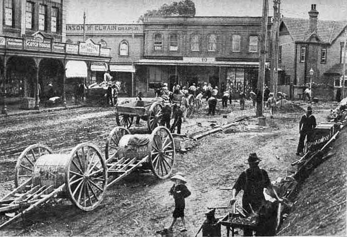 TRAMS ARRIVE: Laying tram lines near the corner of Mount Eden Road and New North Road, Eden Terrace in 1908 (Photo: Sir George Grey Special Collections, Auckland Libraries, 7-A4972)