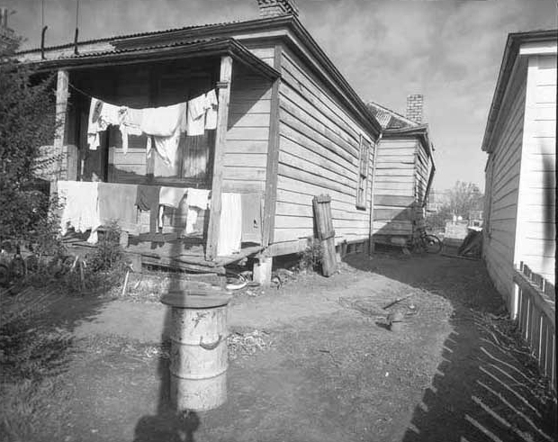 SLUMS: Eden Terrace houses like this one in 1958 were labelled slums and earmarked for demolition (Photo: Sir George Grey Special Collections, Auckland Libraries, 580-3161)