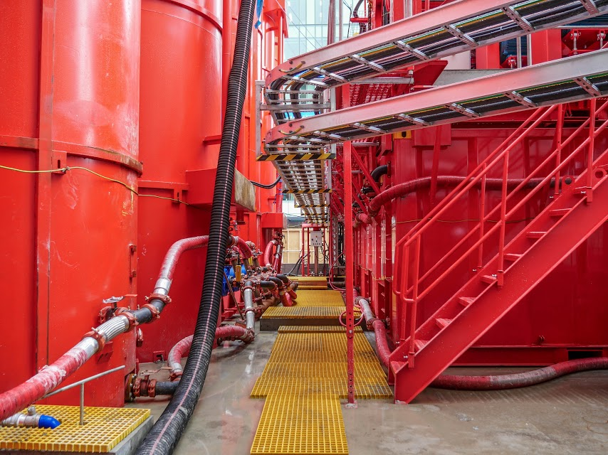 This bright red 90 tonne piling rig named Sandrine worked inside and outside the historic Chief Post Office (Britomart Transport Centre) building until being returned to France in early 2018. During Sandrine's work at the CPO, passers-by got used to seeing the huge 10m high distinctive silos in Lower Queen Street. These were part of the bentonite work.
