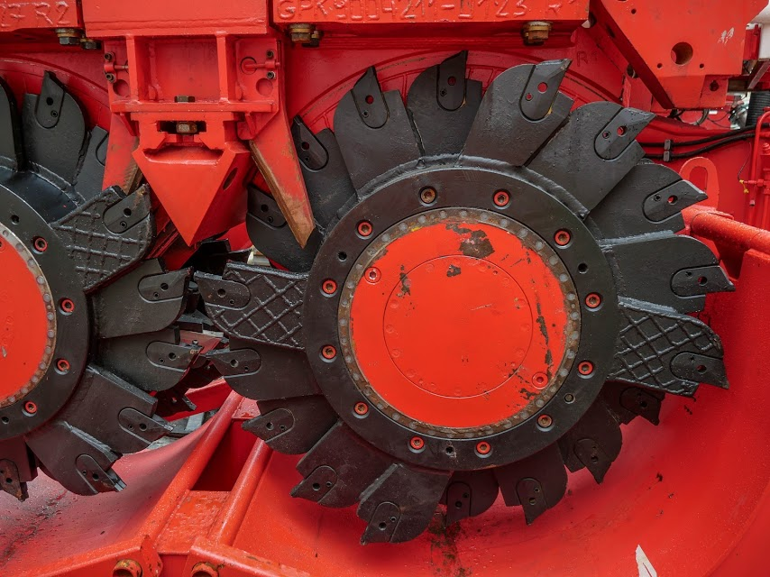 A close up of Sandrine.  This bright red 90 tonne piling rig named Sandrine worked inside and outside the historic Chief Post Office (Britomart Transport Centre) building until being returned to France in early 2018. During Sandrine's work at the CPO, passers-by got used to seeing the huge 10m high distinctive silos in Lower Queen Street. These were part of the bentonite work.