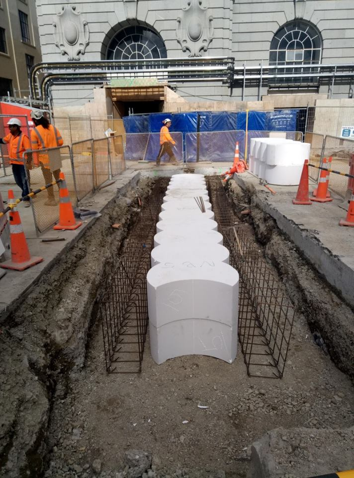 Polystyrene blocks are interlaced together in the excavated pit with rebar cages either side, in Lower Queen Street which will form the guide walls.