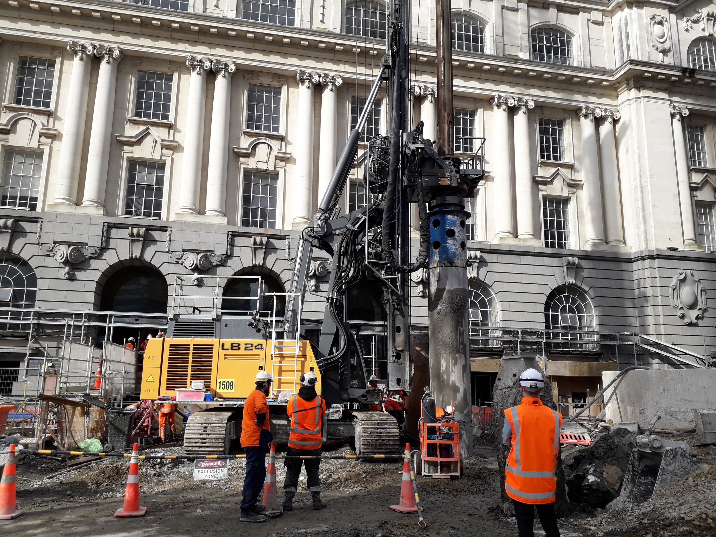 Workers beside the 70-tonne piling rig which was bought in for the drilling of the secant piling in Lower Queen Street