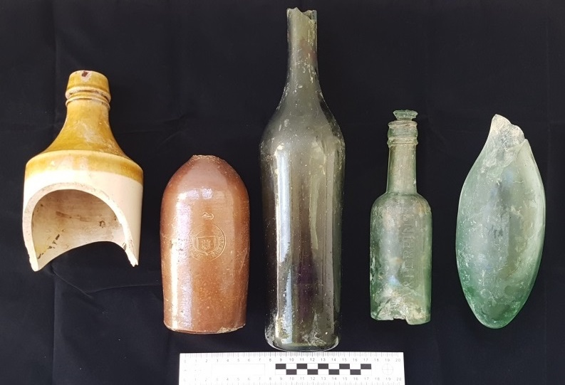 Line up of historical bottles found in May 2017 behind the former CPO