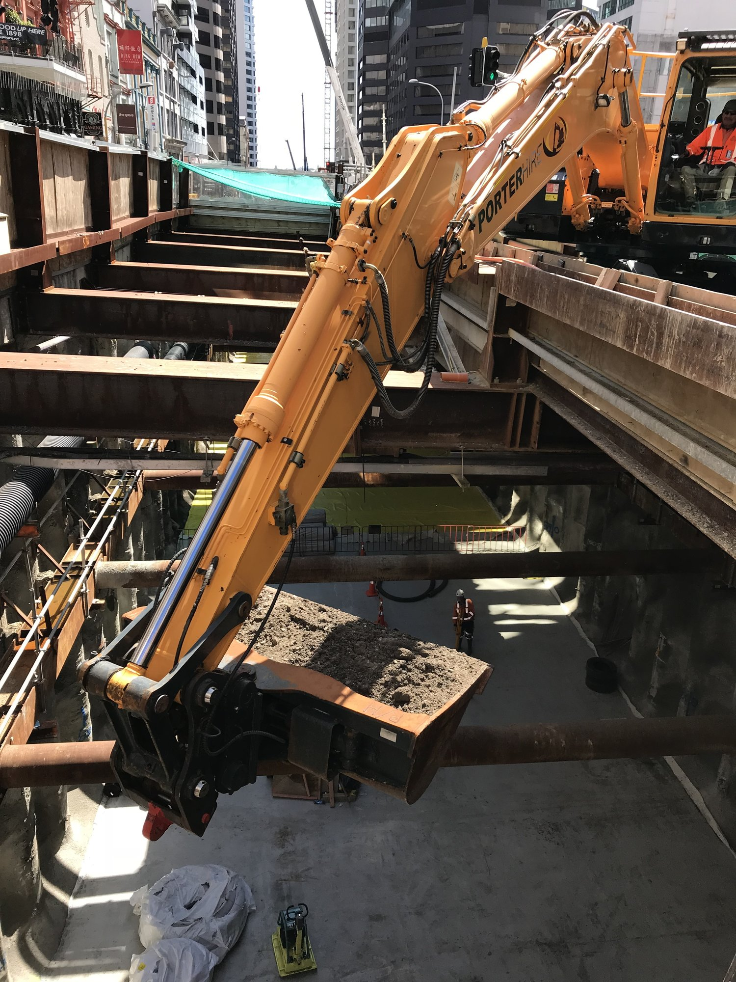 Excavator begins backfilling the City Rail Link trench under Auckland's Albert Street