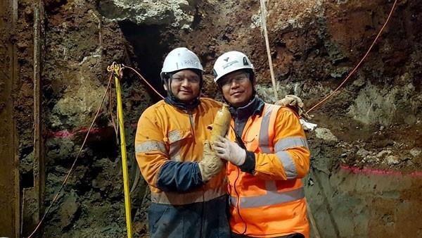 Downer NZ and Soletanche Bachy JV workers Raj and Noel. In September 2018, they uncovered a complete stoneware mineral water bottle from the 1880s. It was produced in the west German Duchy of Nassau, famous for its mineral springs. Ray and Noel found it in reclamation fill, about five metres under modern ground level.