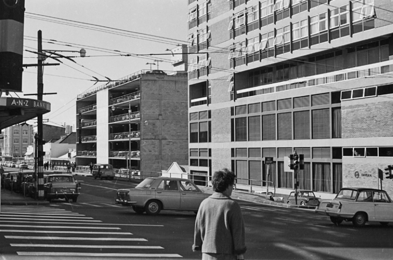 1973: Albert Street, looking north from the Civic Building (Auckland City Council Administration Building) showing the premises of H A Tuck, R G Duffy (Peglers Building), Stirling House and the Public Trust Office. Wellesley Street West can be seen running left to right near the top of the image (Photo: Sir George Grey Special Collections, Auckland Libraries, 786-A019-1)