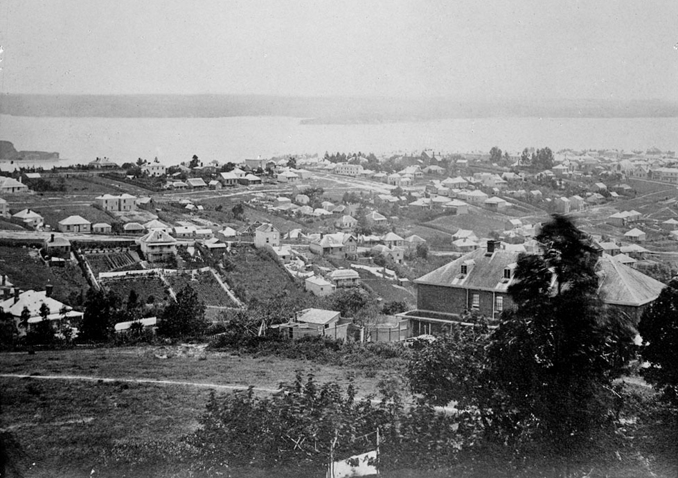 1860: Wellesley Street and Albert Street, are both diagonal right in this panoramic view looking north west from Partington's Windmill in Symonds St towards the harbour and the North Shore showing Wesley College, (right foreground), Grey Street, (left to right across centre), Vincent Street, (left to centre beyond), Federal Street, (centre to right), Cook Street, (diagonal centre): (Photo: Sir George Grey Special Collections, Auckland Libraries, 1-W1844)