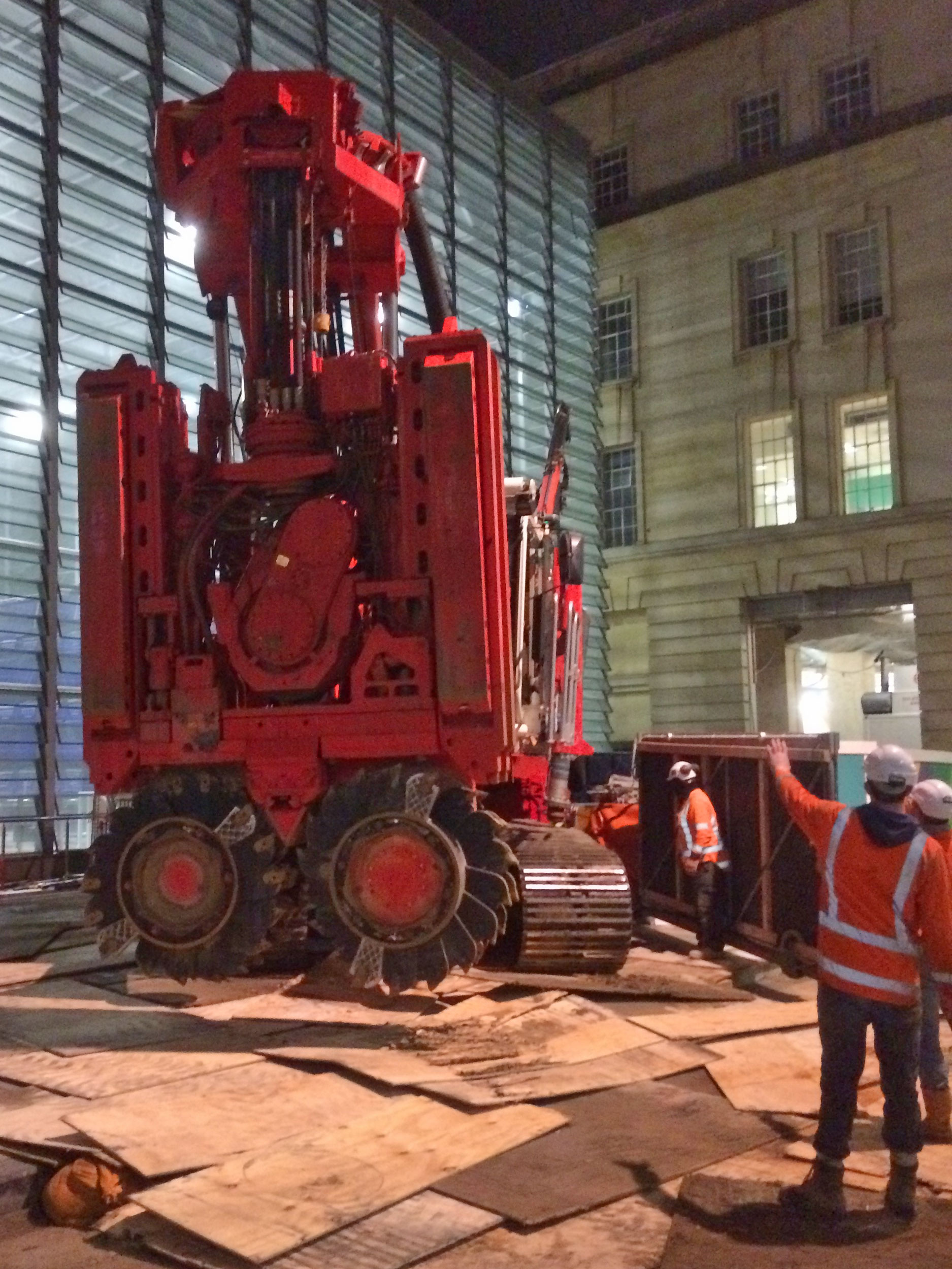 This bright red 90 tonne piling rig named Sandrine worked inside and outside the historic Chief Post Office (Britomart Transport Centre) building until being returned to France in early 2018. This is Sandrine being brought inside the building August 2017.